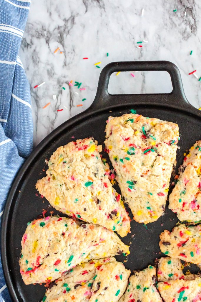 Bottom half of images, white scones with funfetti in are in a black cast iron pan.