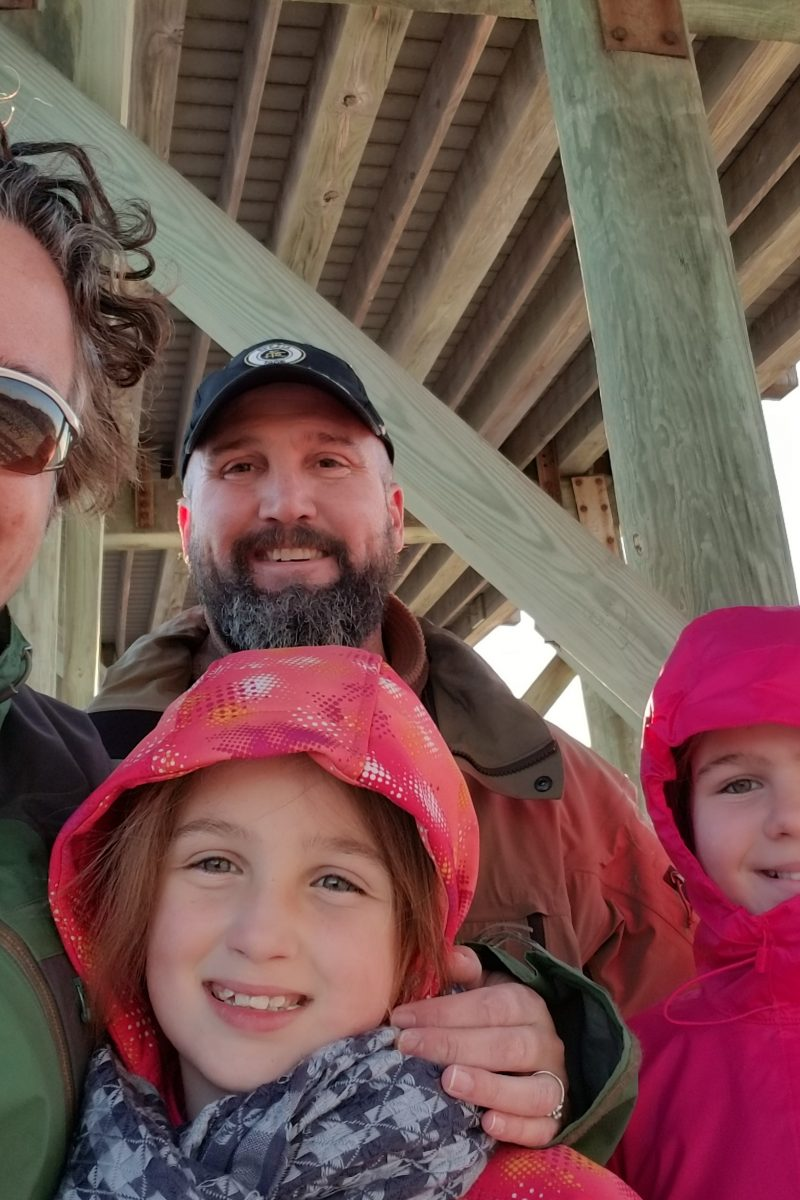 family picture outside under the pier