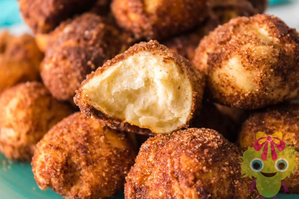 Cinnamon sugar ball cut in half on top of whole balls