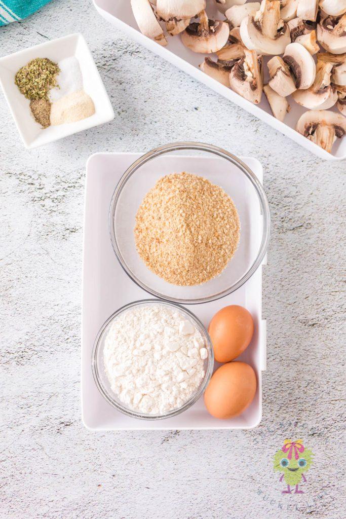 ingredients shots eggs, flour, breadcrumbs, seasonings and mushrooms