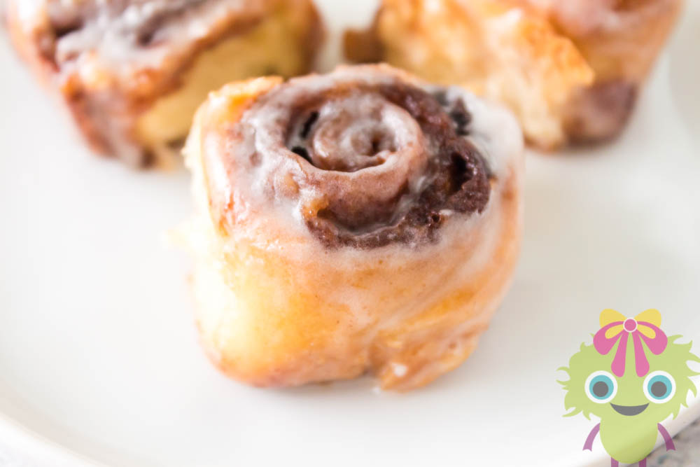 3 mini cinnamon rolls on white plate