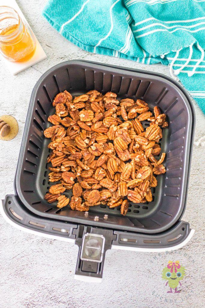 pecans in air fryer before cooking.