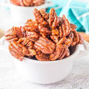 roasted honey almonds in white bowl center