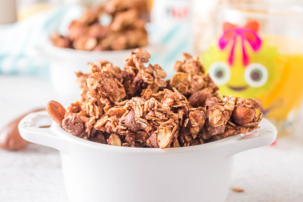 granola cluster in white bowl forward and one in back