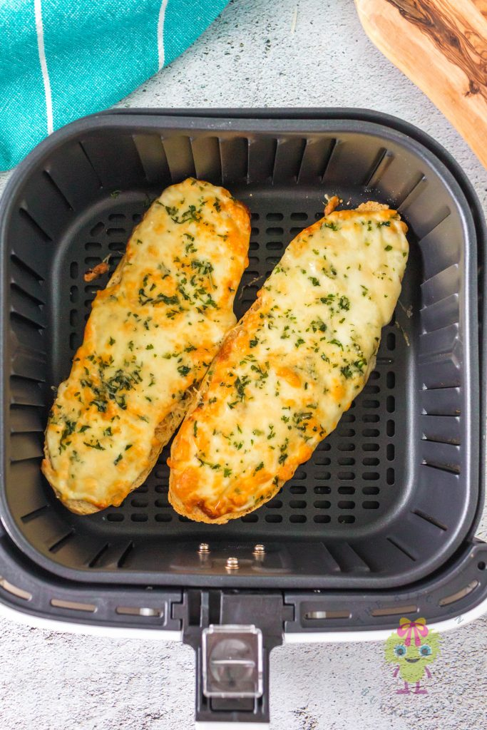 Cooked cheese garlic bread in air fryer basket