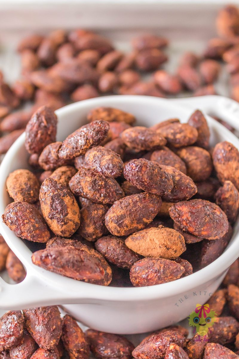 white bowl filled with roasted almonds