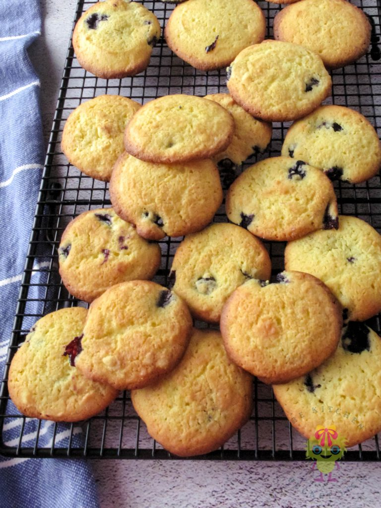 lemon and blueberries cookies on a cooling rack