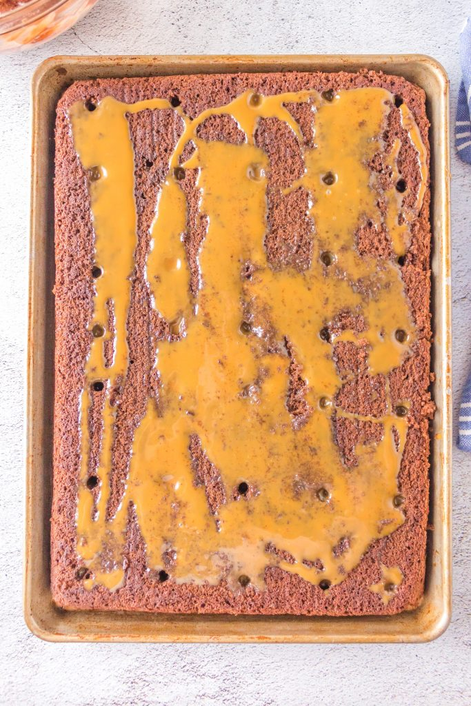 overhead shot of sheet cake with holes and caramel